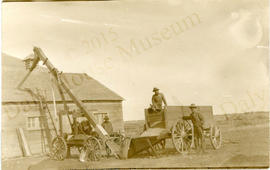 Men Using Auger to Unload Grain - Otto Lau's Farm, Justice (Manitoba)